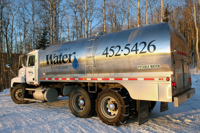 Water delivery truck delivering water