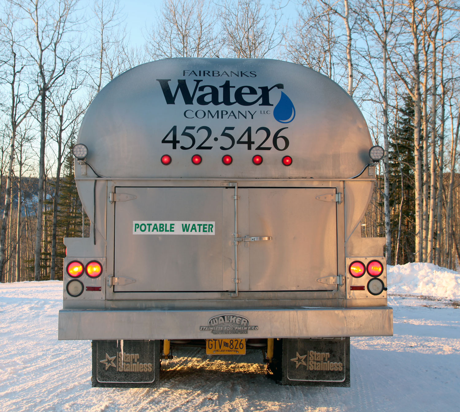 Fairbanks Water Co. delivery truck pulling away